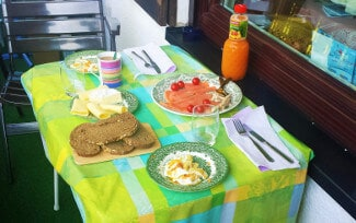 table set with bread, cheese, smoked, salmon, and eggs