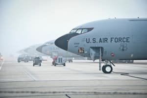 Multiple military aircraft lined up on the runway