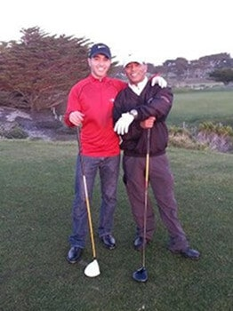 Picture of Mike golfing with his son