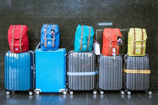 A picture of colorful luggage. Advice for packing for long term travel.