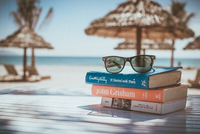 Picture of books stacked on a relaxing beach