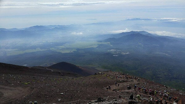 View of the mountains with many hikers climbing Mount Fuji