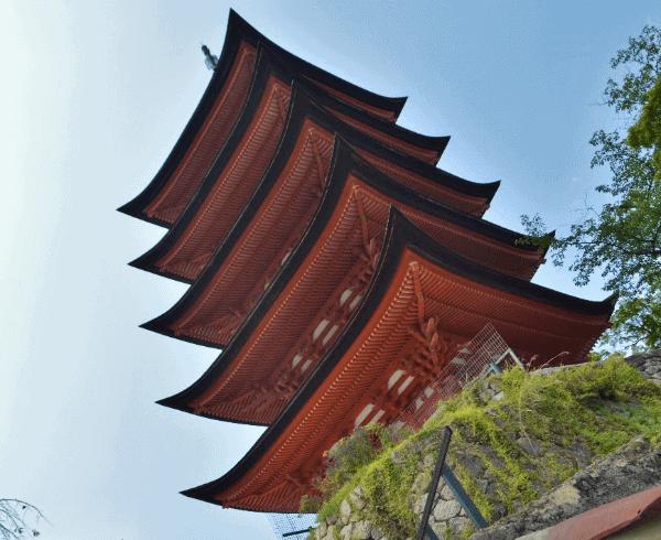 Picture of an orange 5-story pagoda in Miyajima Island