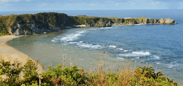 Things to do in Okinawa - view of Cape Hedo from a nearby beach - Poppin' Smoke