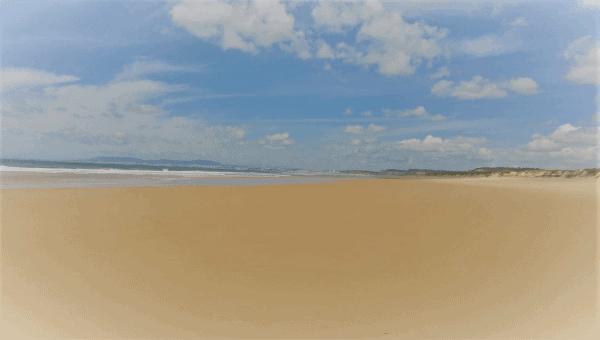 A wide, flat beach in Costa da Caparica, outside Lisbon