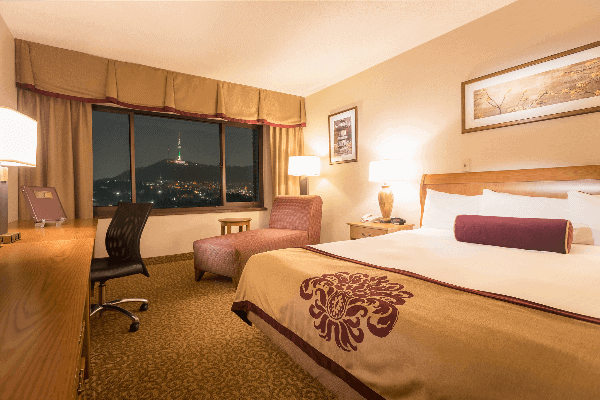 The luxurious rooms at Dragon Hill Lodge with a view of Seoul Tower from the window.