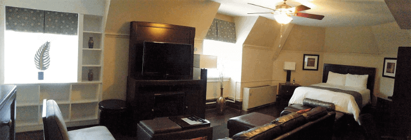 A suite at Navy Getaways Annapolis including a kind size bed and living room