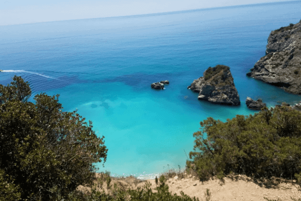 View of the clear blue water at Ribeira do Cavalo in Sesimbre, Portugal